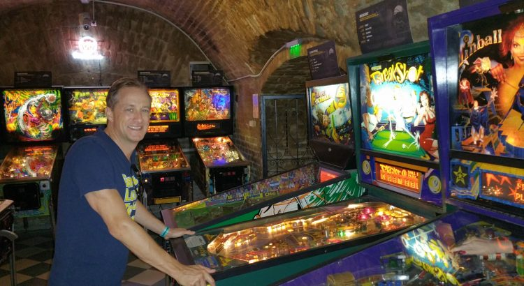Michael Novilla playing pinball in Hungarian Pinball Museum Budapest