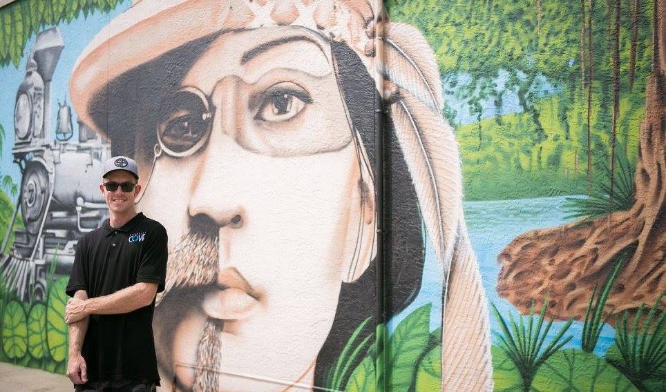 Derek Donnelly with mural photo